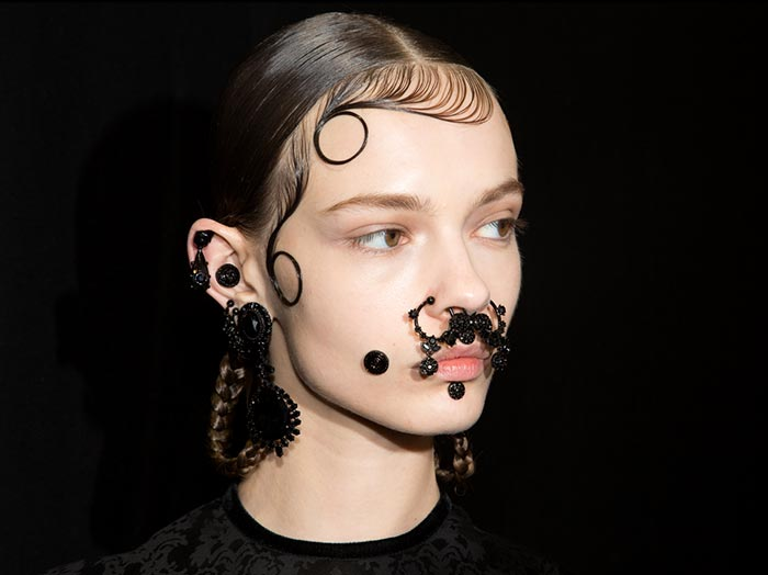 The Fall 2015 Extreme Beauty Trend of Face Piercings and Tattoos