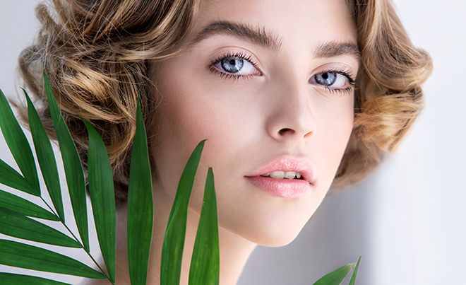 health-uses-for-Hyaluronic-acid-woman-holding-leaf-to-face