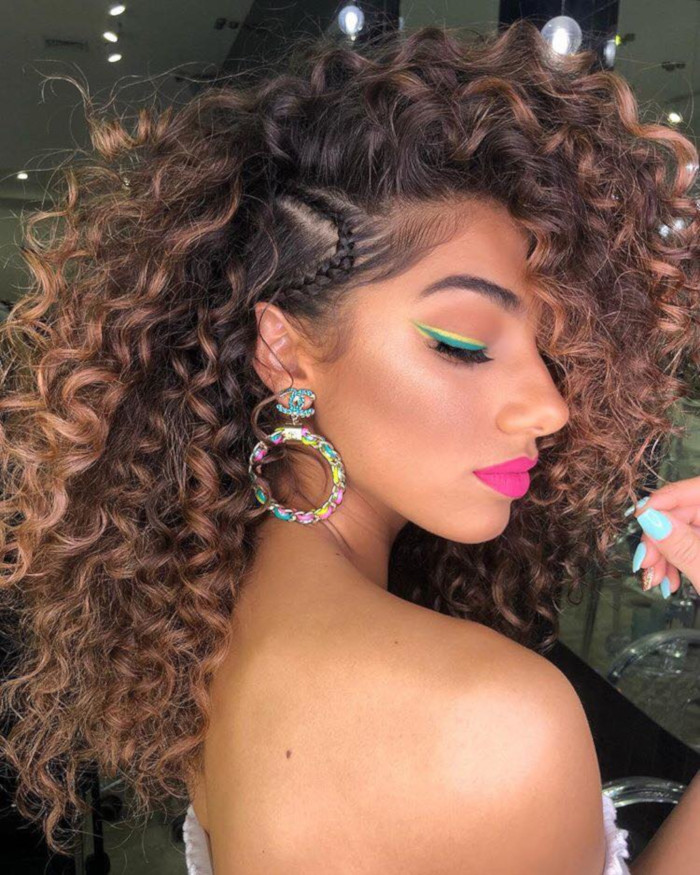 The-Chicest-Holiday-Hairstyles-to-Celebrate-in-Style-curly-hair-with-small-braid