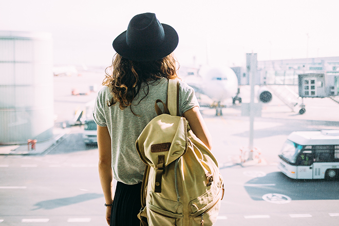 The-Ideal-Ensemble-To-Wear-On-Your-Private-Jet-Trip-woman-with-duffel-bag