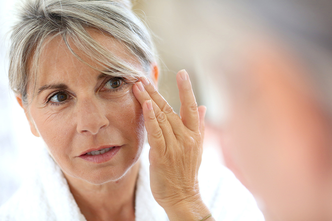 health-uses-for-Hyaluronic-acid-woman-applying-cream-to-face