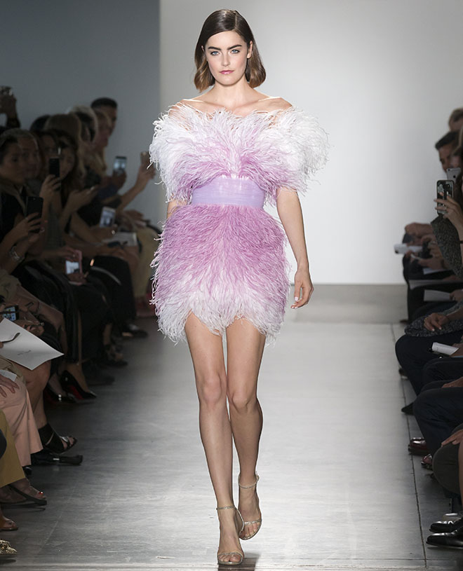 How-Does-an-Agency-Help-Launch-the-Career-of-Young-Aspiring-Models-model-on-runway-in-pink-dress