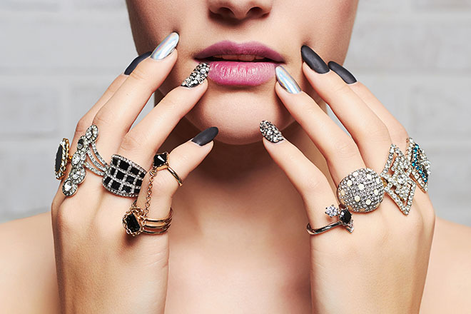 How-to-Choose-The-Best-Jewelry-For-Your-Skin-Tone-woman-wearing-rings