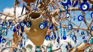 evil-eye-jewelry-hanging-in-tree