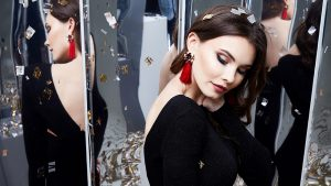 Beautiful sexy woman brunette hair makeup cosmetic for face wear luxury clothes elegant dress style for celebrate party holiday Christmas New Year mirror shiny sequins earrings model fashion jewelry.