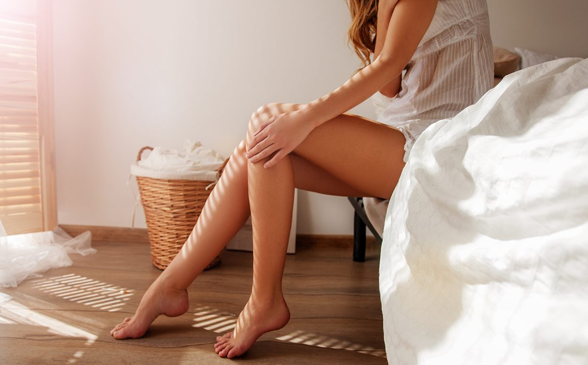 mattresses-are-becoming-part-of-home-design-girl-sitting-on-edge-of-bed
