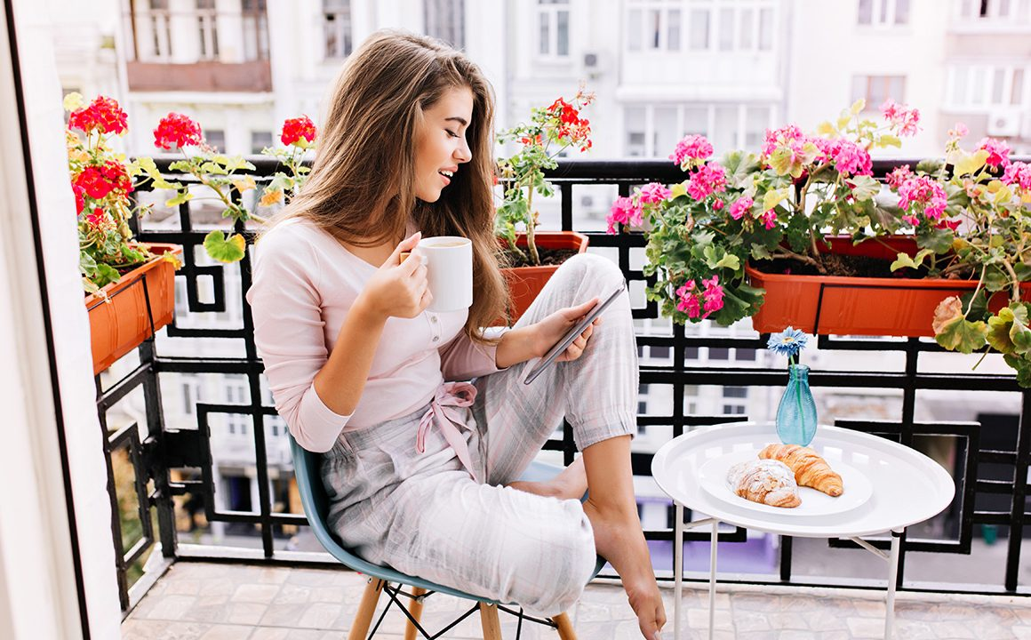 indoor-activities-to-try-this-summer-girl-sitting-at-outdoor-balcony-at-home-main-image