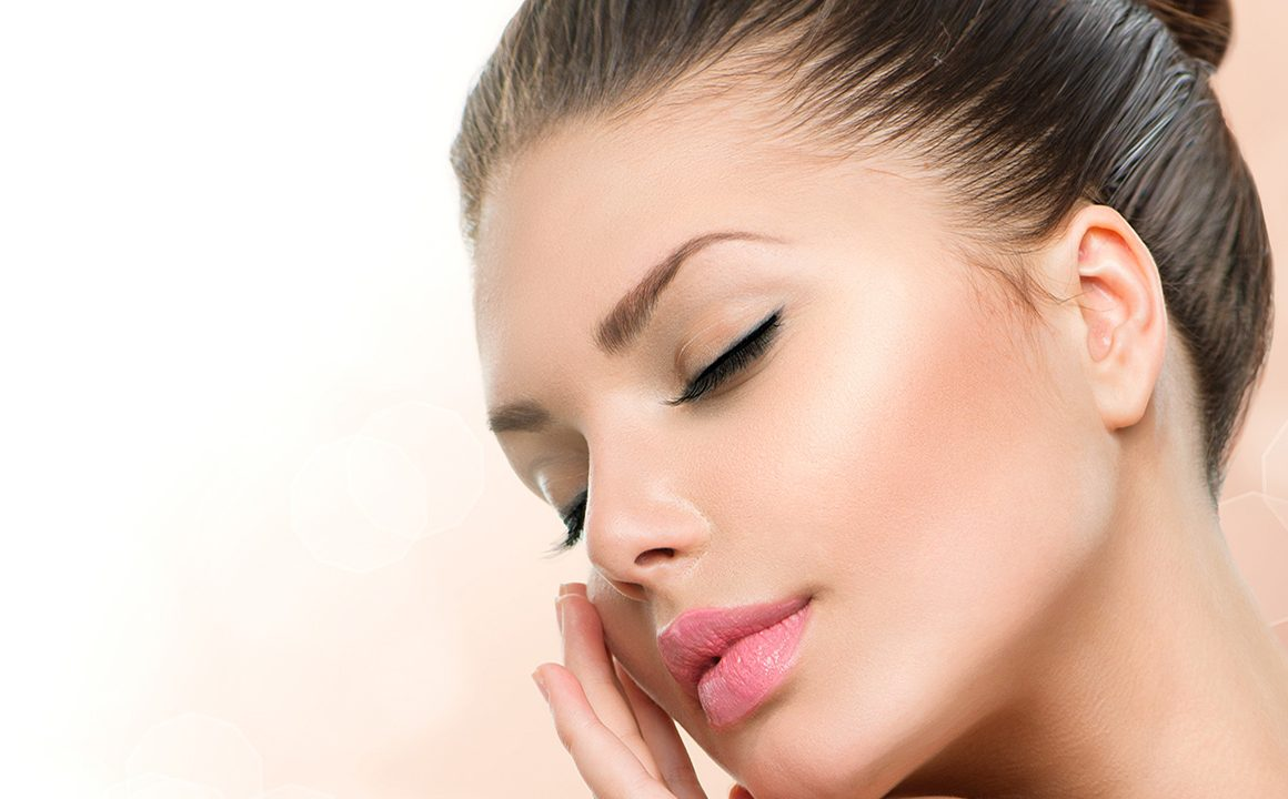diy-dermatologist-approved-skin-treatments-for-radiant-skin-main-image-woman-holding-face