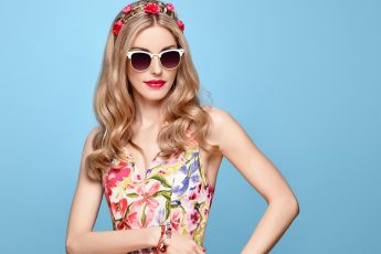 colors-that-flatter-blondes-main-image-blonde-in-floral-dress-against-blue-background