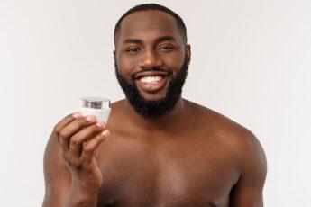 facial-hair-trends-for-men-man-holding-beard-main-image2