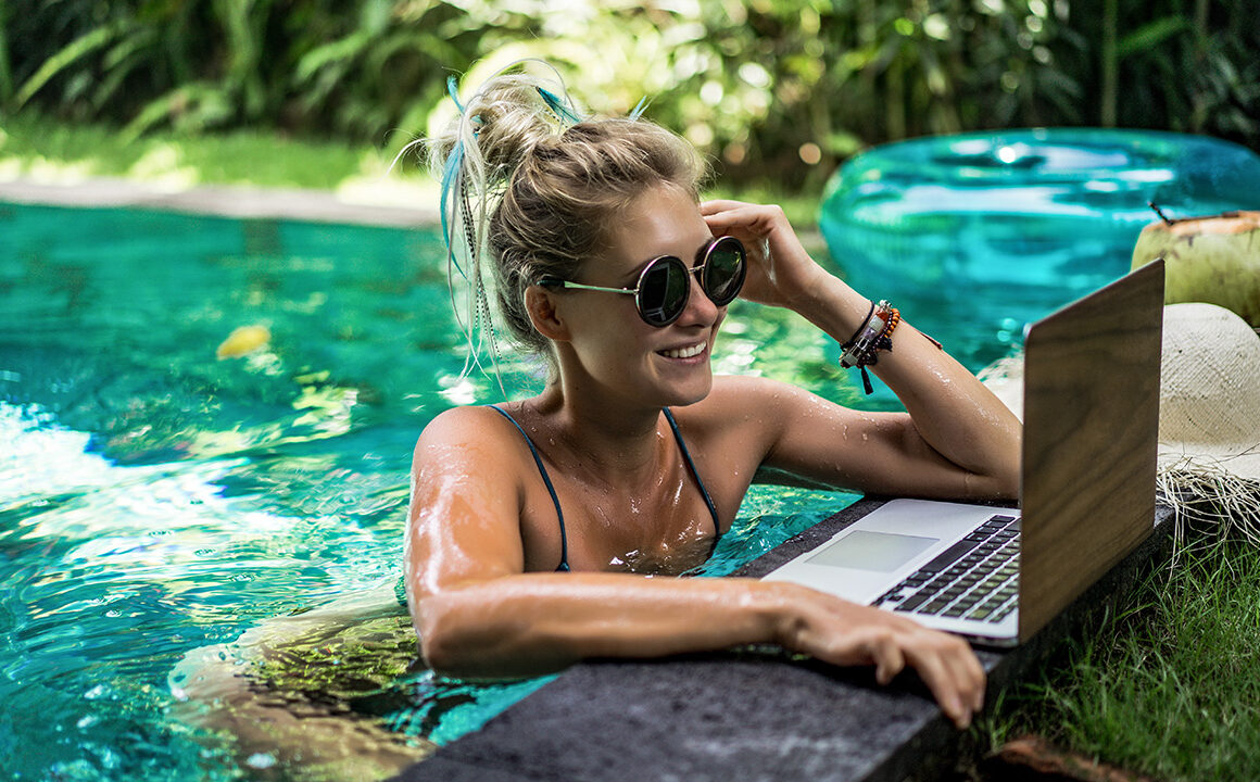 fun-things-to-try-on-instagram-girl-on-computer-in-pool