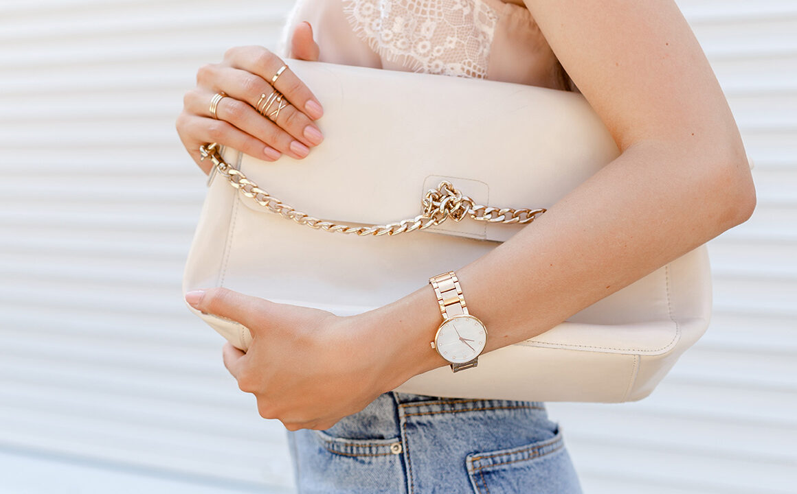 watch-design-to-match-your-outfit-woman-holding-purse-with-watch-on-main-image