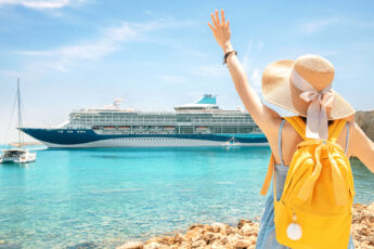 easy-and-stylish-ways-to-wear-your-hair-wen-traveling-woman-waving-at-cruise-ship