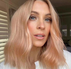 golden peach hair color is the unexpected pastel pink sister that's trending this fall