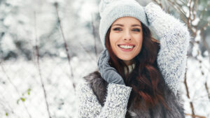 how-to-style-a-sweaterdress-this-fall-main-image-girl-in-sweater-dress-with-scarf-gloves-hat