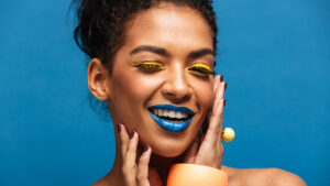 unique-jewelry-that-wont-break-the-bank-woman-with-colorful-makeup-and-jewelry