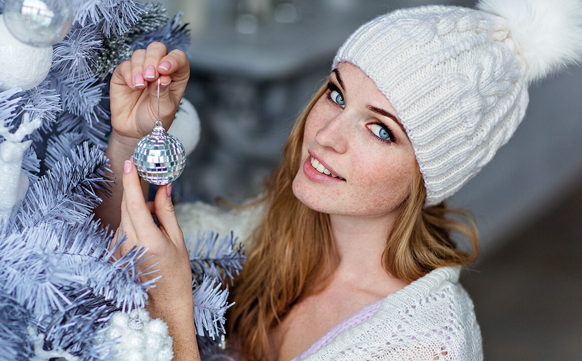 decorate-your-home-for-each-holiday-woman-decorating-christmas-tree