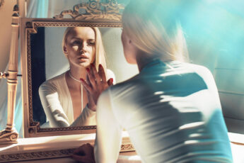 dont-love-the-way-your-clothing-fits-procedures-to-fix-it-woman-looking-in-mirror