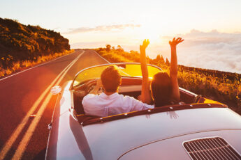 features-standard-in-luxury-vehicle-man-and-woman-on-joyride