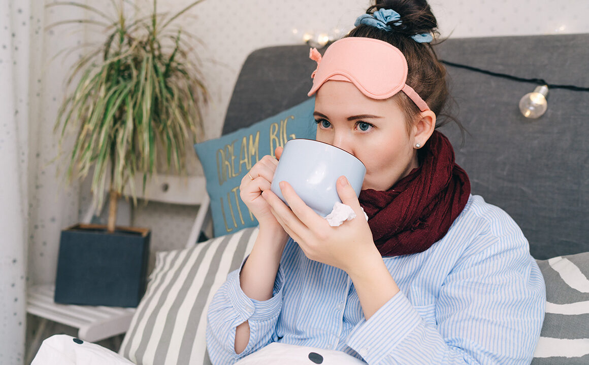 top-5-at-home-self-care-treatments-woman-bundled-up-at-home-drinking-tea