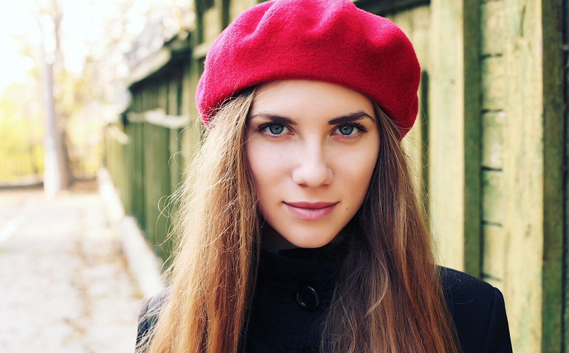 what-you-should-know-about-your-thyroid-health-information-woman-in-beret-looking-at-camera