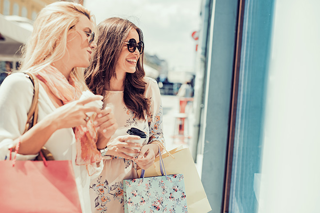 women-shopping-looking-in-storefront