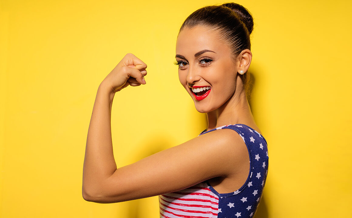 9-surprising-benefits-of-taking-probiotics-woman-flexing-arm-strength
