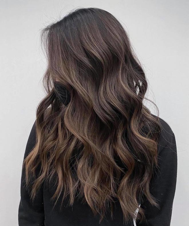 ash brown hair is the trendiest wearable dye job to rock this season