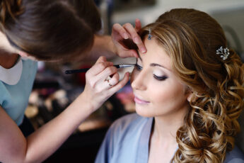 boost-success-in-right-beauty-school-cosmetology-applying-makeup
