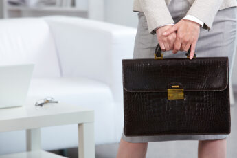 find-the-right-leather-briefcase-woman-holding-case