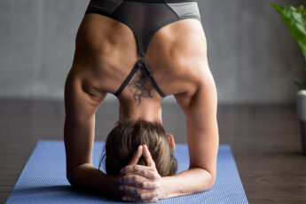 yoga-tattoo-what-a-yoga-tattoo-represents-main-image-woman-doing-yoga-pose-with-tattoo