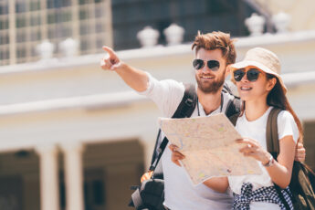 can-i-visit-australia-with-criminal-record-couple-holding-map-tourists