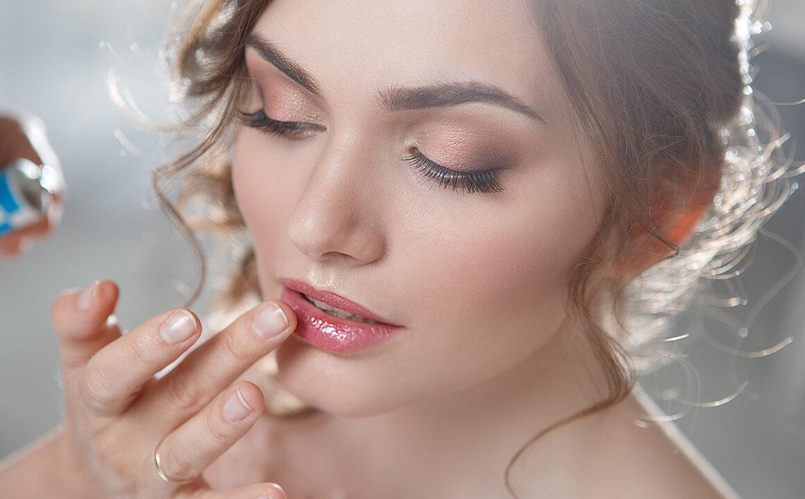 find-a-good-beauty-school-woman-applying-bridal-makeup-main-image