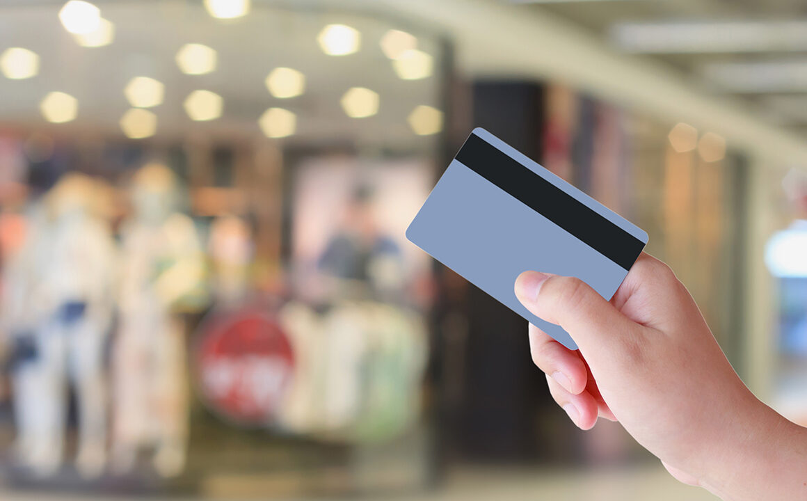 how-important-is-store-layout-to-business-success-shopper-with-credit-card-infront-of-store