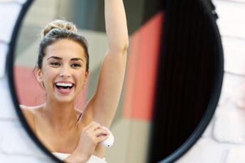 painless-wax-tips-tricks-woman-happily-epilating-arm