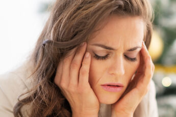 imple-solution-to-decrease-stress-levels-woman-holding-head