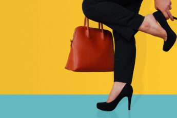 why-do-you-need-comfortable-work-shoes-woman-holding-heel-yellow-background