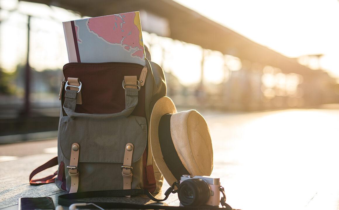 care-tips-for-designer-bags-travel-bag-full-of-travel-items