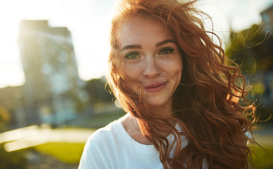 happy-young-red-head-woman