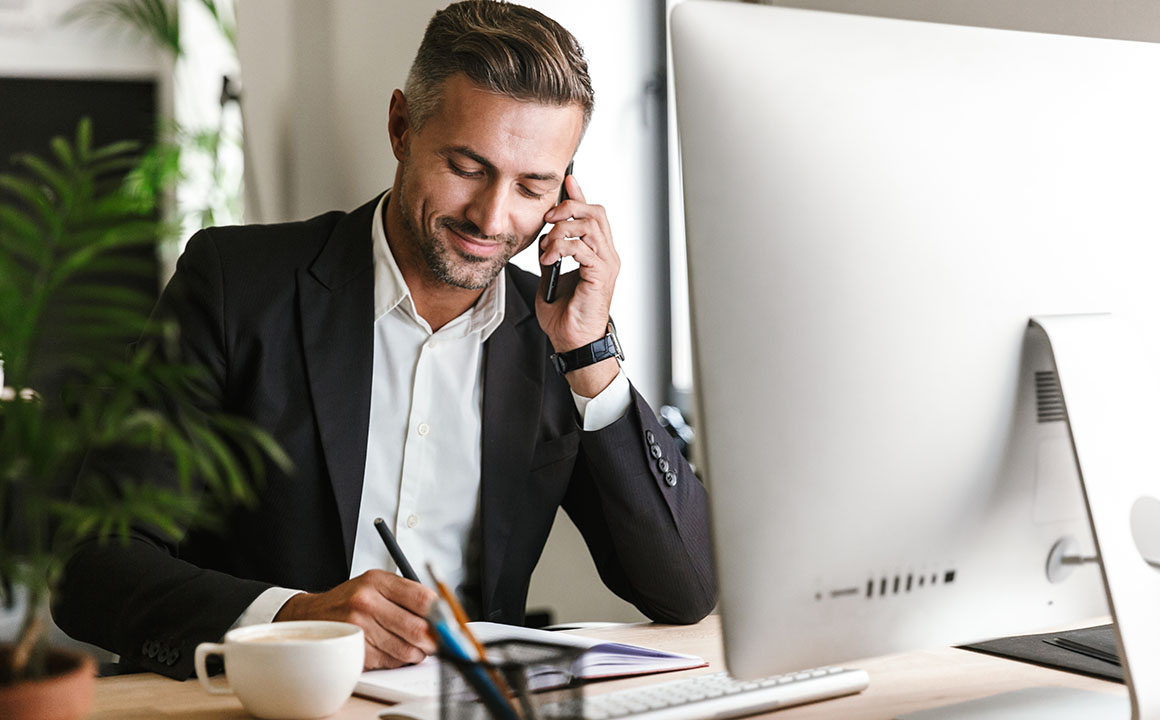 elegant man working in his office