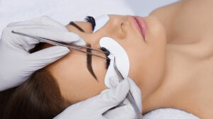 everything-about-eyelash-extensions-woman-getting-extensions-main-image