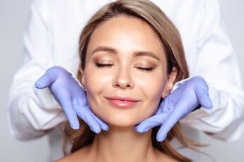 most-popular-plastic-surgeries-right-now-main-image-woman-smiling-with-nurse