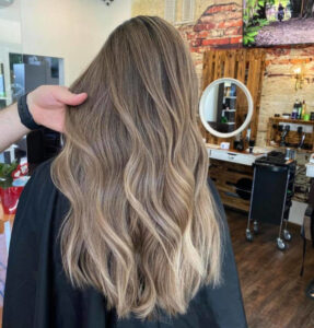 the melted pecan hair color trend is here to spice up your summer look