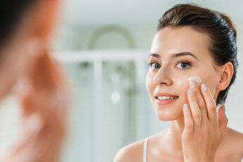 transform-you-life-with-clean-beauty-woman-putting-beauty-product-on-face
