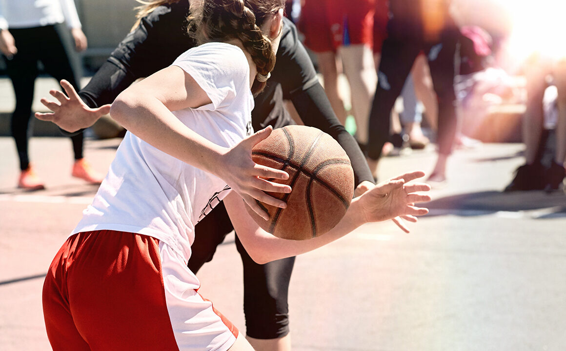 how-to-train-to-the-level-of-wnba-athlete-main-image-girls-playing-basketball