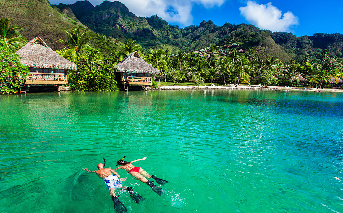 little-known-tips-for-low-cost-trips-main-image-couple-scuba-diving-tropical