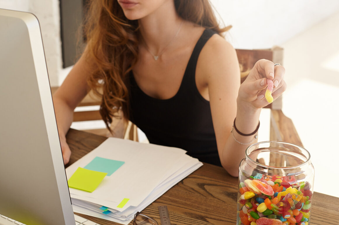 delete-your-digital-footprint-woman-snacking-with-gummies-while-on-thecomputer