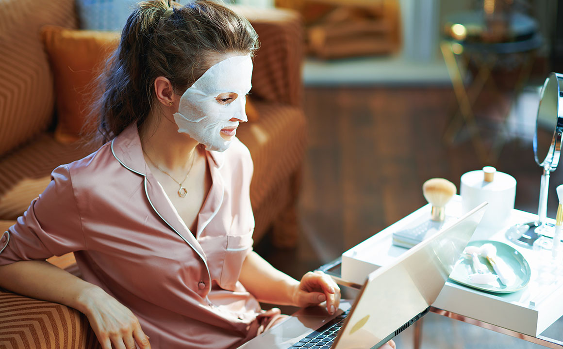 woman-shopping-skincare-on-computer