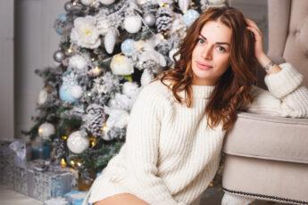 christmas-fragrances-woman-sitting-by-christmas-tree
