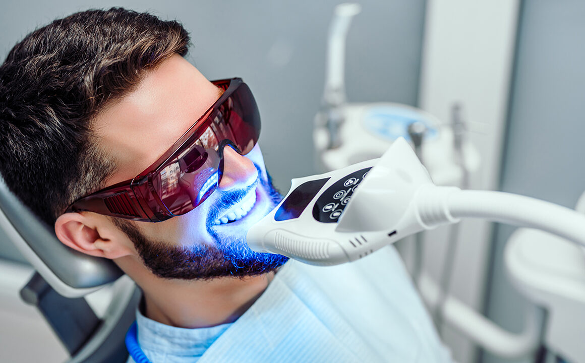 dental-cosmetic-procedures-that-bring-out-perfect-smiles-man-getting-teeth-whitened-main-image
